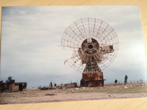 An abandoned radio telescope dish in Kuwait