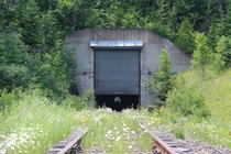 An abandoned railroad tunnel in Minnesota The retractable door was to prevent snow accumulation in the winter