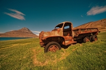 An abandoned rusting truck in the beautiful fields of Iceland