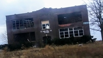 An abandoned school in the country Picture is a bit blurry and had to be edited to see better since it was taken in a moving car