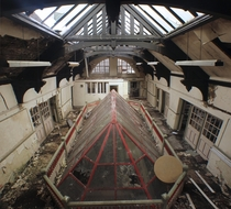 An abandoned school Originally with an open balcony that that decided to fill with this unusual glass ceiling
