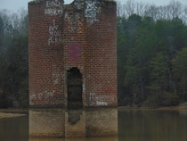 An abandoned silo partially submerged by the Tellico Lake It is one of many such silos remnants of old farms that once operated in the Little Tennessee River Valley prior to the completion of the Tellico Dam in  Vonore TN