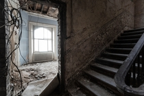 An abandoned stairway  doorway UK