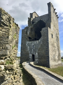 An abandoned tower castle damaged by cannonball blast Near the Shannon River Ireland  OC