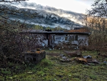 An abandoned trailer at the foot of the mountains Vancouver Island