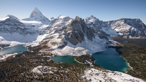 An aerial of Mount Assiniboine in the Fall Canadian Rockies Alberta taken from a helicopter  Instagram adamgearing