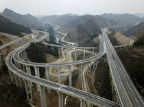 An aerial view of an intricate interchange on the Anshun-Ziyun Expressway China