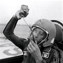 An Air Force test pilot drinking grape juice while wearing an MA- High Altitude Flight Helmet