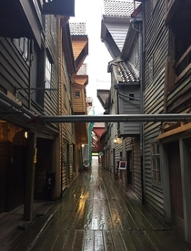 An alley in the old harbour Bryggen Bergen Norway