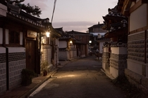 An alley lit during the evening in the historic Bukchon Hanok Village Jongno District Seoul South Korea