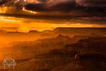 An amazing moment as rain and hail are illuminated by the sun as it sets on the Grand Canyon
