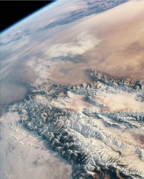 An astronaut in the international space station took this highly oblique photograph of the eastern Tien shan and Taklimakan desert in Central Asia