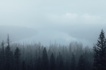 An early morning snow-storm overlooking Holland Lake nestled in the mountains of Montana