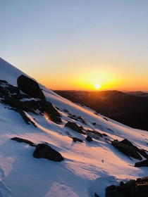 An early spring sunrise illuminating the snows on Mount Lafayette in New Hampshire