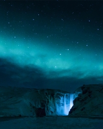 An eerily beautiful night sky over Skgafoss Iceland