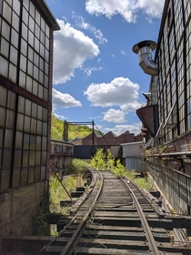 An Elevated Rail Leading into the Courtyard of an Abandoned Papermill