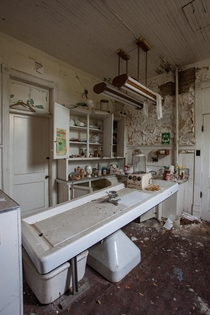 An embalming room inside an abandoned funeral home OCx