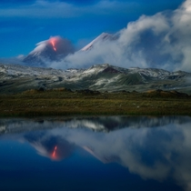 An erupting volcano during blue hour in the far east of Russia Kamchatka