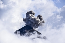 An eruption among the clouds Volcan de Fuego Guatemala x