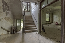 An excellent abandoned building in New York State natural light lots of great staircases and decay oc x