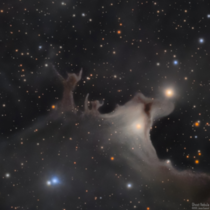 An ghostly figure stands over two light years tall in the dust of our Milky Way As a Halloween treat I created this portrait with over  hours of exposure through an amateur telescope