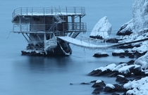 An ice-covered structure built on a rock in the Black Sea off the Crimean coast