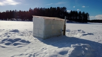An ice sauna on a lake in Lapland Finland