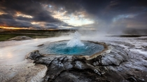An Icelandic geyser beginning to erupt  photo Alban Henderyckx