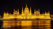 An illuminated Hungarian Parliament Building Budapest Hungary Designed by Imre Steindl