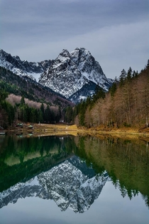 An impecable reflection of Alpspitze in Reissersee Garmisch Germany