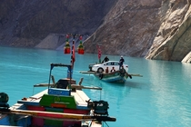 An improvised ferry in Attabad Lake Northern Pakistan  By Asad Munir