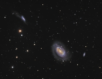 An Interacting pair of galaxies NGC and  with a spectator galaxy NGC