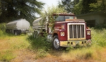 An International Transtar  with tanker and trailer lies abandoned in Gig Harbor Washington by Pipe Dreamer