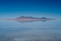 An island reflecting in the great Salt Lake in Utah The water and sky meeting at the horizon