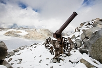 An Italian cannon still stands on Cresta Croce a -meter-high ridge in the Alps One of many artifacts including mummified soldiers revealed by the retreating ice Photo by Stefano Torrione