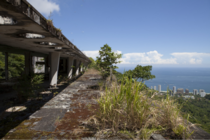An old abandoned hotel in the mountains of Rio de Janeiro with incredible views of the ocean from its crumbling roof Brazil