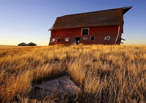 An old barn reshaped and missing its doors as a result of years of westerly winds on the Canadian Prairies Shot in the province of Saskatchewan by SYMPL IMAGES