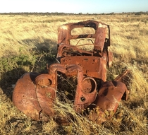 An old car in the grass