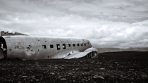 An old DC- plane-wreck on the deserted black beaches of Slheimasandur in Iceland by stefanbecker