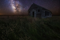An old decaying schoolhouse under the Milky Way in South Dakota  by Aaron J Groen