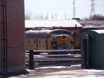 An old diesel train from the s sitting in Cheyenne tucked away missing its wheels