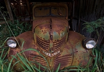 An old Dodge truck slowly rots away in an abandoned garage on the island of Lanai Hawaii OC  x
