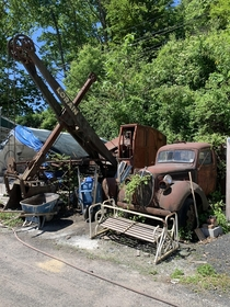 An old ford pick up truck and a old excavator at my familys old quarry where they keep all of their stuff Never asked whos truck it was but Im pretty sure its my grandfathers and its been there my entire life Ill post more pictures if anyone wants them