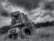 An old harvester at an abandoned farm Central VA