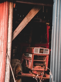An old international peeking out from the barn