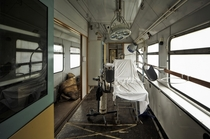 An old medical train in Germany consisting of  wagons including operating room sleeping wagon kitchen etc  locomotive By AndreasS