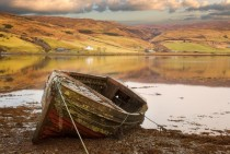 An old moored boat on a loch Isle of Skye Scotland