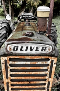 An old Oliver tractor rusting away at an abandoned dairy farm NE of Toronto in Pickering