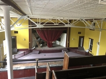 An old opera house turned into a church The new owner has one handyman attempting to renovate it