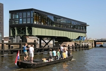 An old railway swing bridge in Amsterdam converted into a restaurant Pay attention to how the windows open